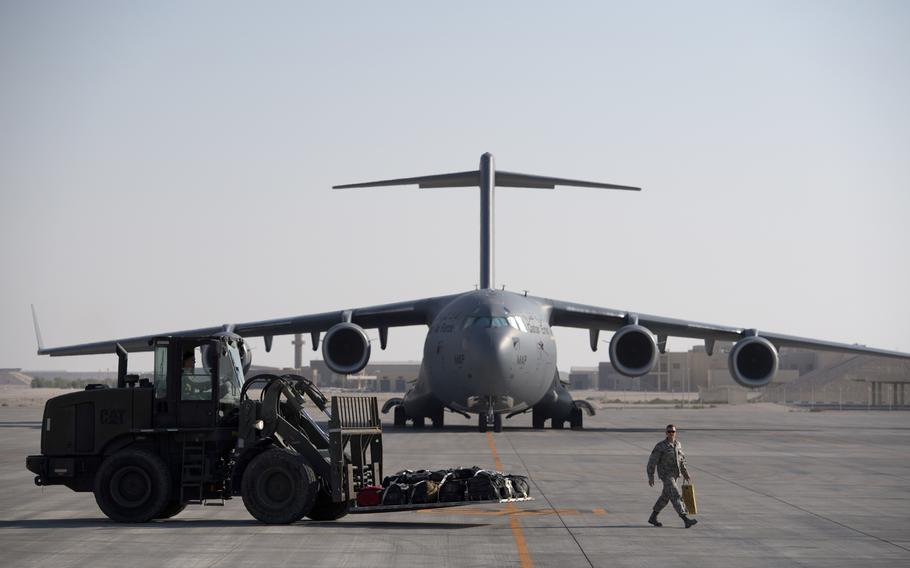 A U.S. Air Force C-17 Globemaster III is loaded at Al Udeid Air Base, Qatar, Dec. 21, 2017. Qatar wants to make the air base more family friendly for U.S. forces in the hopes that the strategic military hub will be counted as one of the Pentagon's permanent overseas installations.