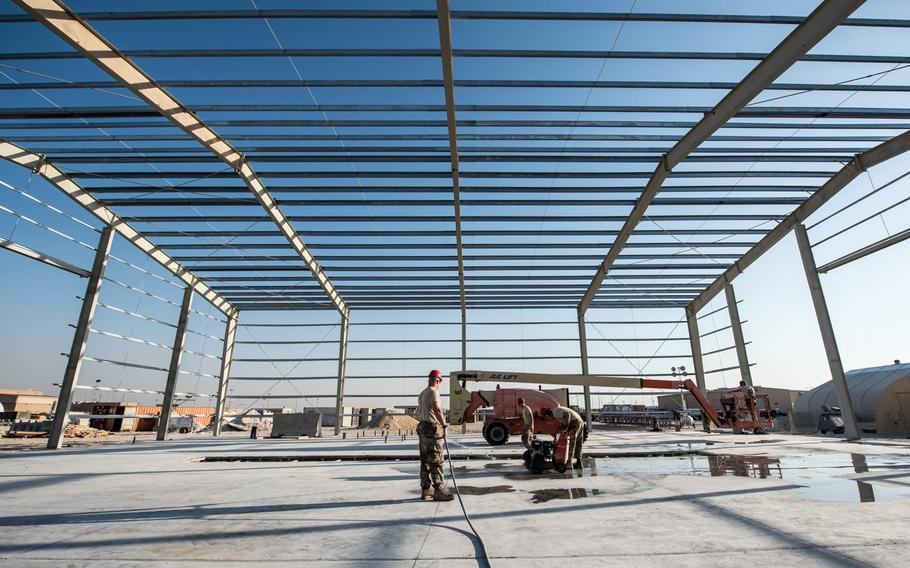 Airmen from the 557th Expeditionary Rapid Engineer Deployable Heavy Operational Repair Squadron Engineers  Squadron work on a new structure for vehicle maintenance at Al Udeid Air Base, Qatar, Dec. 20, 2017. Qatar wants to make the air base more family friendly for U.S. forces.