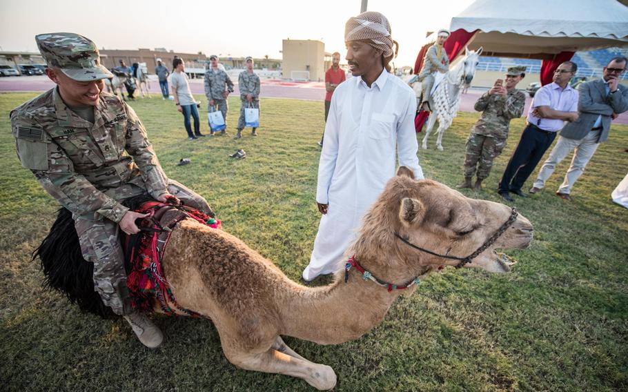 A U.S. soldier takes a ride on a camel at the Qatari Emiri Air Force Family Cultural Exchange at Al Udeid Air Base, Qatar, Dec. 1, 2017. Qatar wants to make the base more family friendly for U.S. forces in the hopes that the it will be counted as one of the Pentagon's permanent overseas installations.