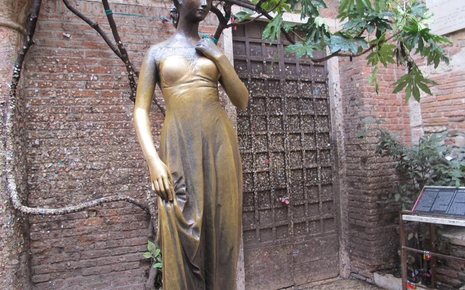 The bronze statue of Shakespeare's Juliet is in the courtyard of the Cappelletti house in Verona, Italy.