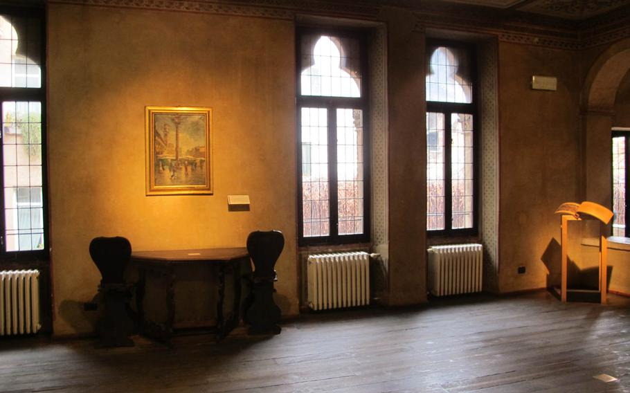 The interior of Juliet's Gothic-style house in Verona, Italy, is sparsely decorated with furnishings representative of the 14th-century Italian haute bourgeoisie. Shakespeare's play was preceded by an Italian tale of doomed young lovers from wealthy, blood-feuding families.