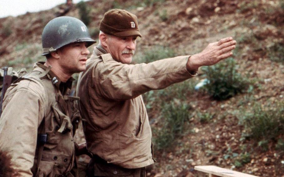 """Dale Dye directs Tom Hanks on the set of Steve Spielberg's """"Saving Private Ryan."""" Dye, a Marine combat veteran, served as a technical adviser and actor on the film."""