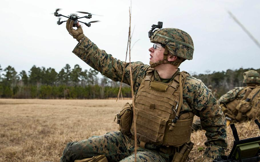 Lance Cpl. James R. Fiers Jr., a rifleman with Battalion Landing Team, 2nd Battalion, 6th Marine Regiment, 26th Marine Expeditionary Unit, launches a drone during live-fire training at Camp Lejeune, N.C., Jan. 17, 2018.