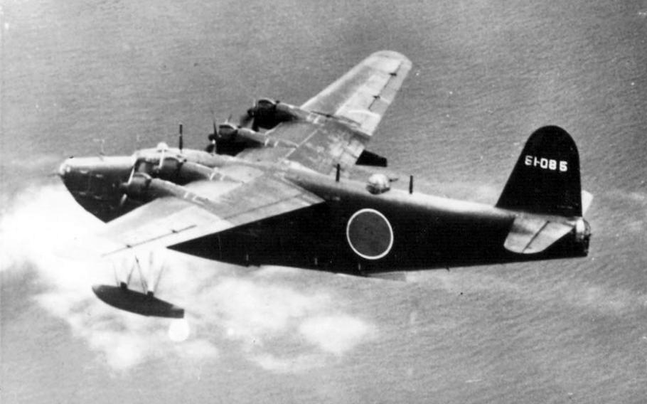 A Japanese Kawanishi H8K is seen seconds before being shot down by a Navy aircraft in July 1944.