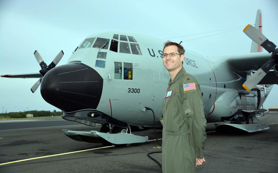 Maj. Malcolm Schongalla of the New York Air National Guard's 109th Airlift Wing poses at Joint Base Pearl Harbor-Hickam, Hawaii, beside the LC-130 he piloted in Antarctic, Feb. 28, 2018.