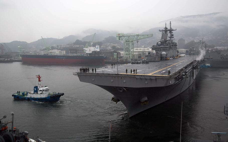 The amphibious assault ship USS Wasp departs Sasebo Naval Base, Japan, Saturday, March 3, 2018.