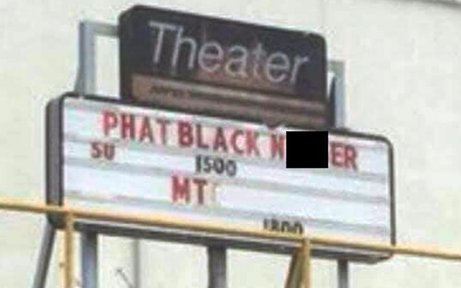 The Marine Corps is investigating after a racial slur was posted on a movie theater marquee over the weekend at Camp Hansen, Okinawa.