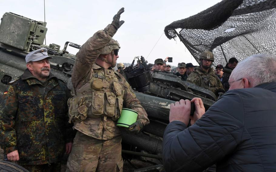 Local community leaders take pictures of U.S. and German soldiers during exercise Dynamic Front, at Grafenwoehr, Germany, Monday, March 5, 2018.