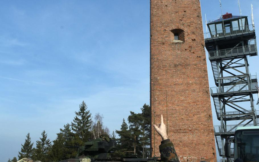 U.S. and German Army soldiers show German mayors and community leaders an aged observation tower during exercise Dynamic Front, at Grafenwoehr, Germany, Monday, March 5, 2018.   Martin Egnash/Stars and Stripes