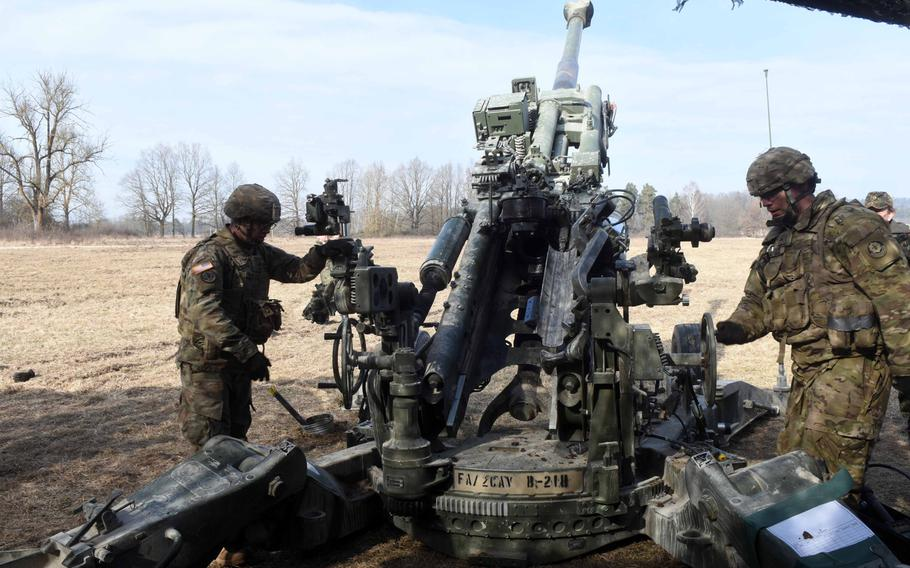 U.S. Army soldiers demonstrate how to fire a 155 mm Howitzer to German mayors and community leaders during exercise Dynamic Front, at Grafenwoehr, Germany, Monday, March 5, 2018.