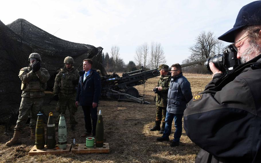 U.S. Army representatives show German mayors and community leaders different types of artillery rounds during exercise Dynamic Front, at Grafenwoehr, Germany, Monday, March 5, 2018.