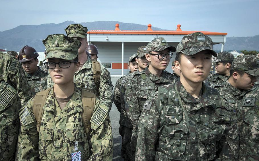 U.S. and South Korean sailors listen to a safety briefing during a Foal Eagle exercise in Jinhae, South Korea, March 13, 2017.