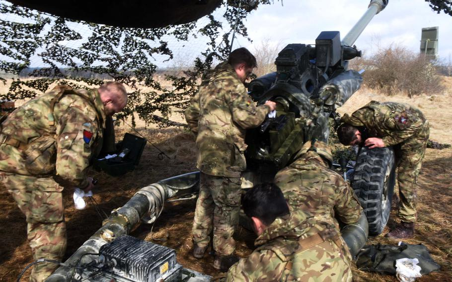 British soldiers perform maintenance on an L118 Light Gun during Exercise Dynamic Front 18 at Grafenwoehr, Germany on Wednesday, March 7, 2018.