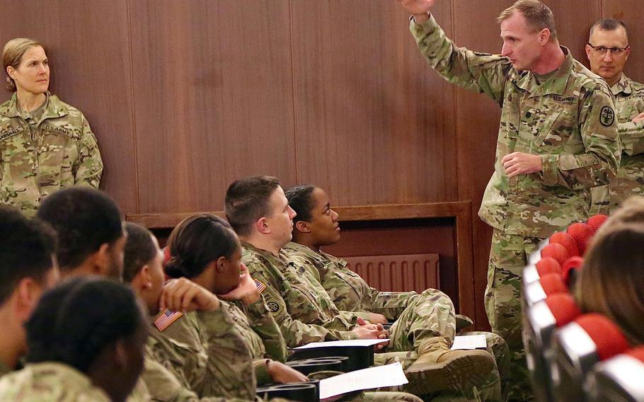 Lt. Col. Troy Morton, commander of the Baumholder Health Clinic, explains Legionnaires' disease to troops on Wednesday, March 7, 2018. The soldiers live in barracks that tested positive for Legionella bacteria, which causes the disease.  Will Morris/Stars and Stripes
