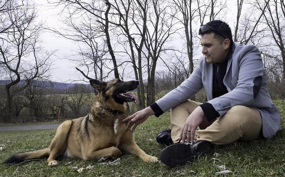 31p bs Tactical explosives detection dog Ben and his former handler, National Guardsman Julio Munoz, get reacquainted during their reunion in York, Pennsylvania in 2016. Ben's adopted owner Kim Scarborough sought out Munoz after she got the dog from the Army in 2014.