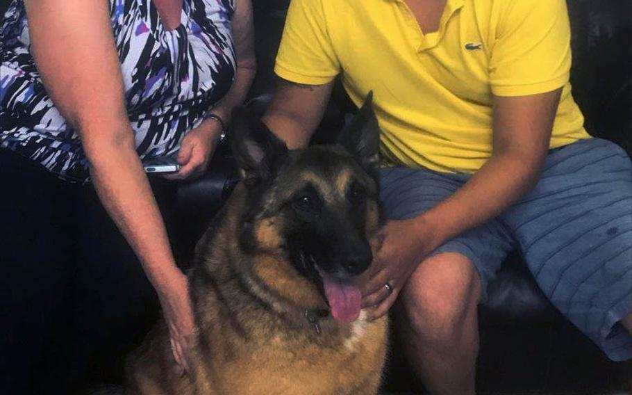 25p bs Kim Scarborough, right, tactical explosives detection dog Ben and Julio Munoz, his former handler, catch up at Scarborough's Kinston, North Carolina home in August 2017. Scarborough sought to reunite Ben and Munoz after she adopted Ben from the