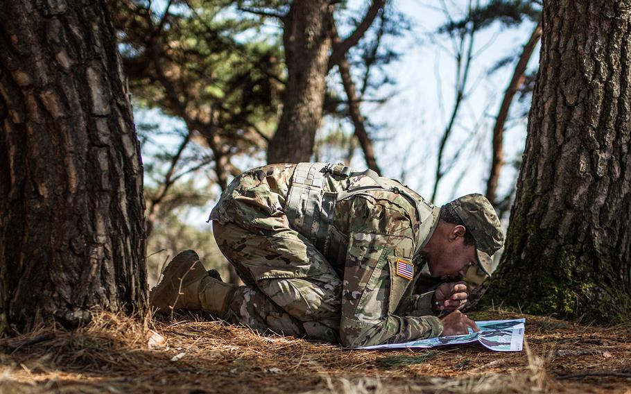 Sgt. William Stallworth of 176th Financial Management Support Unit, 498th Combat Support Sustainment Battalion plots points for land navigation during the 19th Expeditionary Command best-warrior competition, Tuesday, March 6, 2018.