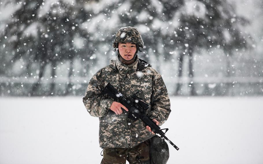 A 19th Expeditionary Sustainment Command best-warrior competitor poses at Camp Walker, South Korea, Thursday, March 8, 2018.