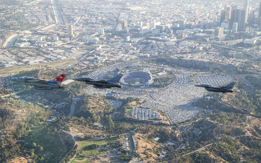 Three F-16 Fighting Falcons from Edwards Air Force Base fly past Dodger Stadium after a ceremonial flyover for Game Two of the World Series, Oct. 25, 2017.