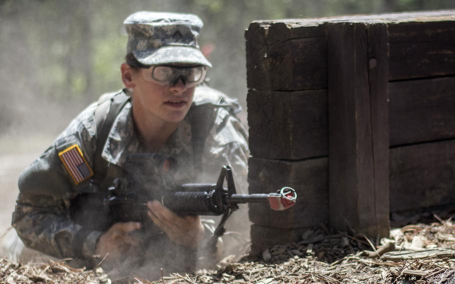 U.S. Army recruit Madison Elam, 19, of Vandalia, Ohio, rushes into position to cover her battle buddy during basic training at Fort Jackson, S.C., in 2015.  A new study found that unit cohesion was unaffected by adding women.