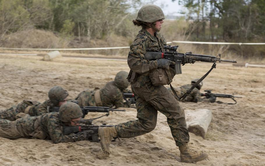 U.S. Marine Corps Rct. Gianna Paul during Basic Warrior Training at Paige Field on Marine Corps Recruit Depot, Parris Island, S.C., on Feb. 7, 2018.  A new study found that unit cohesion was unaffected by adding women.