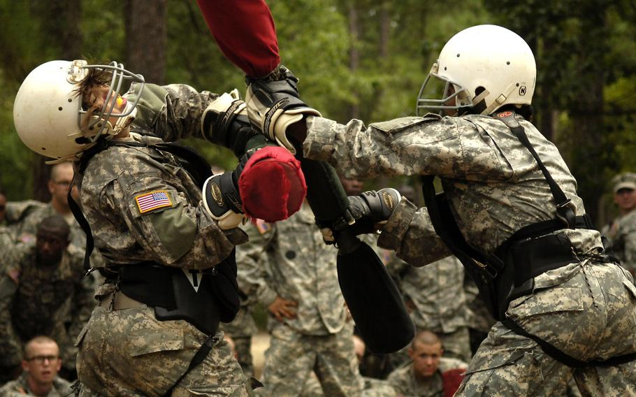 Army trainees practice hand-to-hand combat using pugil sticks during basic combat training at Fort Jackson, S.C.  A new study found that unit cohesion was unaffected by adding women