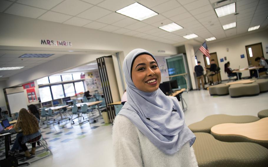 Daegu Middle High School senior Nurfatihah Melendez talks about the open-classroom concept at her school at Camp Walker, South Korea, Friday, March 9, 2018.