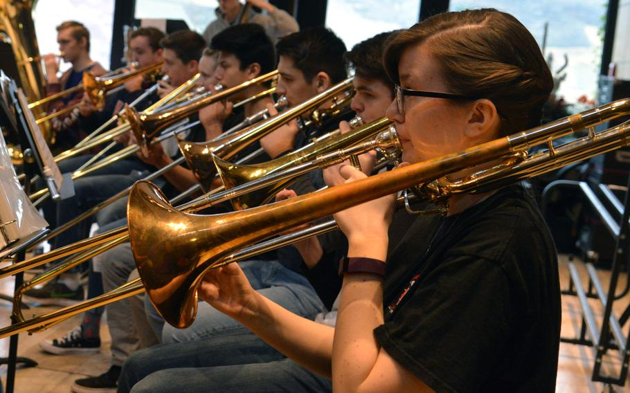 The trombone section of the DODEA-Europe Honors Band rehearses a number at this year's Honors Music Festival, Tuesday, March 13, 2018.