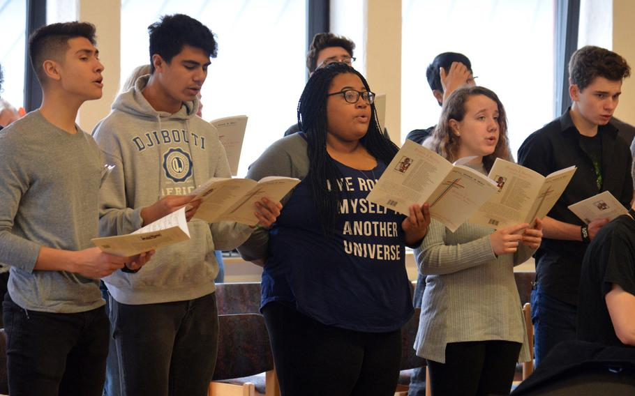 Members of the choir rehearse a song at the DODEA-Europe Honors Music Festival, Tuesday, March 13, 2018. Representing 17 high schools, nearly 150 singers and musicians participated in this years weeklong event.