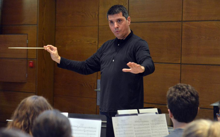 Guest conductor Damon Talley leads the band through a number at the DODEA-Europe Honors Music Festival, Tuesday, March 13, 2018.
