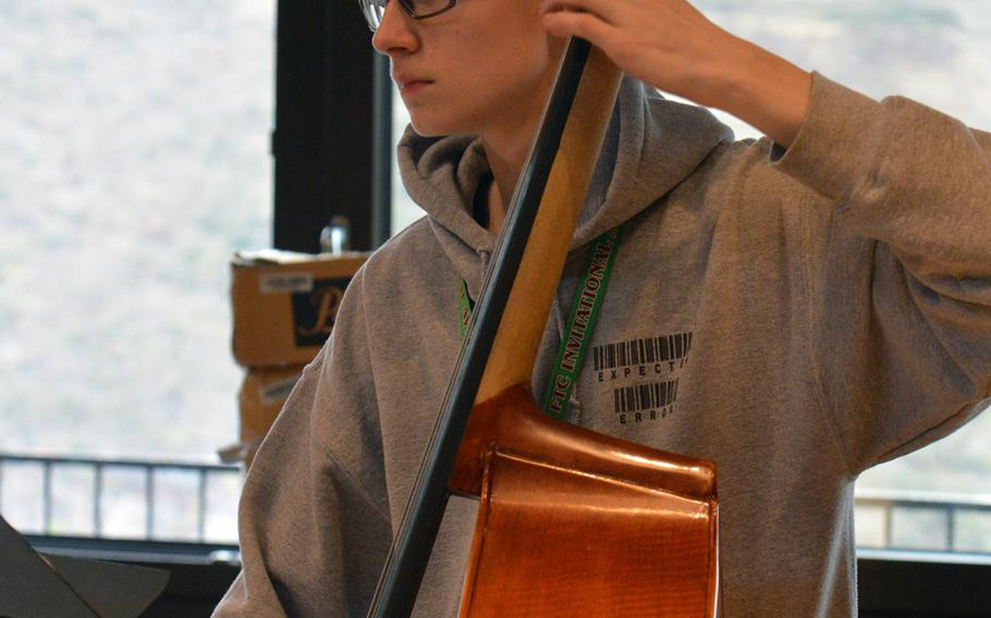 String bassist Jacob Nelson of Aviano waits for his cue at this year's DODEA-Europe Honors Music Festival, Tuesday, March 13, 2018.