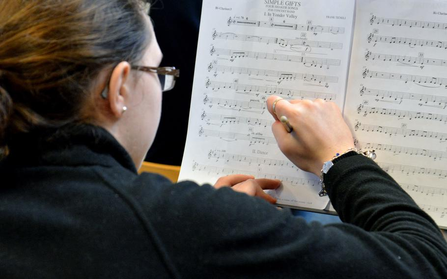 Marianna Szukala, a clarinetist from Alconbury High School, makes some changes to her notes as she and the band rehearse at this year's DODEA-Europe Honors Music Festival, Tuesday, March 13, 2018.