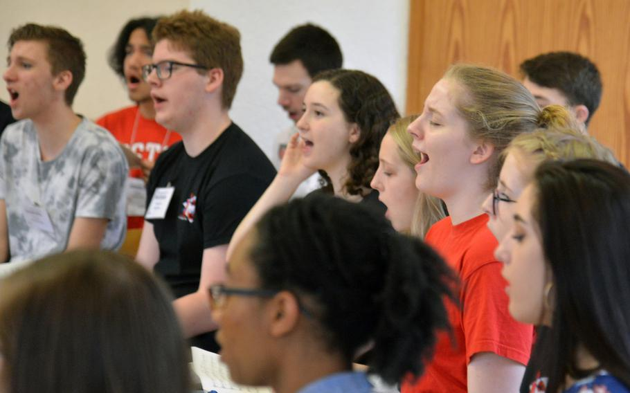 Members of the choir go through a number at the DODEA-Europe Honors Music Festival, Tuesday, March 13, 2018.
