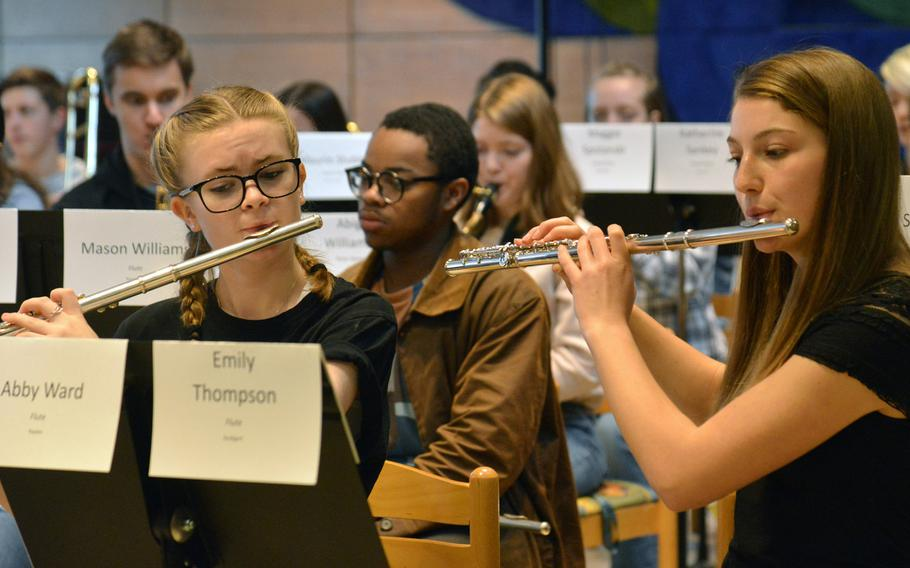 Abby Ward and Emily Thompson, flautists with the DODEA-Europe Honors Band rehearse a song at the Honors Music Festival, Tuesday, March 13, 2018.