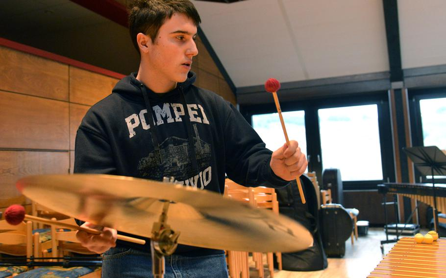 Percussionist Jonathan Ciero of Ramstein hits the cymbal as he rehearses a song with the band at the DODEA-Europe Honors Music Festival, Tuesday, March 13, 2018.