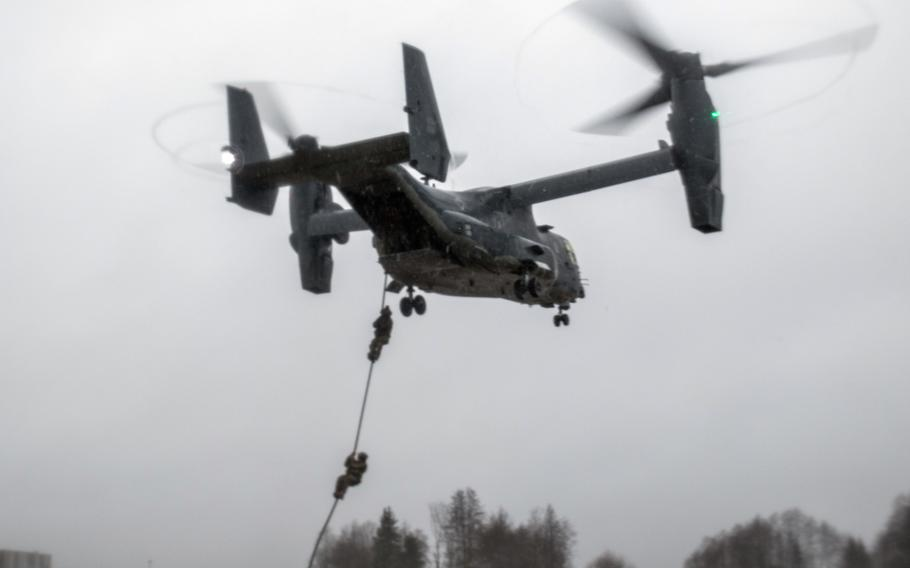 Estonian and U.S. Special Operation Forces operators fast rope out of a U.S. Air Force CV-22 Osprey, assigned to the 352d Special Operations Wing, during training near Amari, Estonia, Dec. 12, 2017.