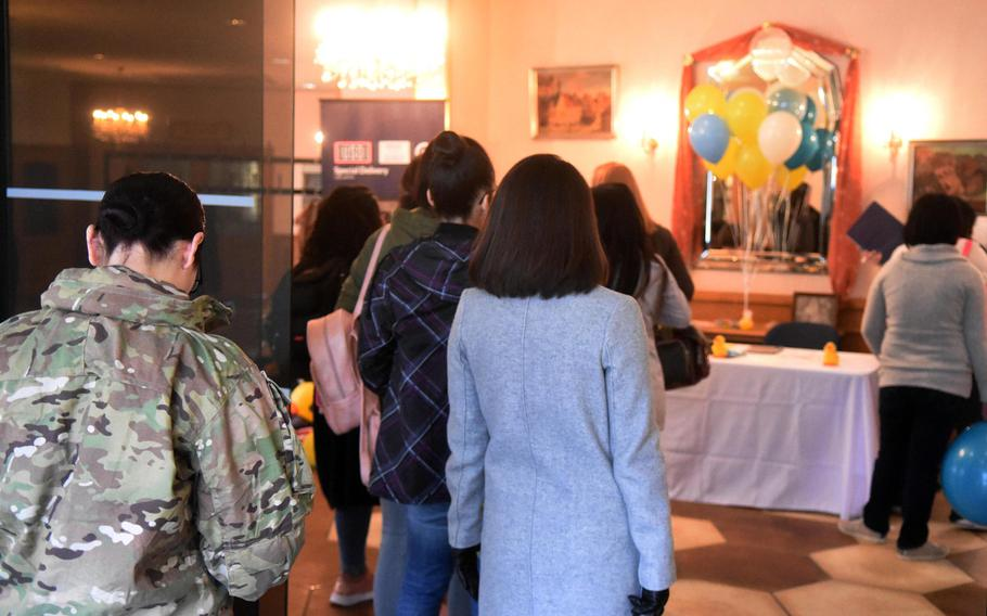 Expectant mothers from U.S. Army Garrison Bavaria line up at the Special Delivery baby shower event, at Grafenwoehr, Germany, Wednesday, March 14, 2018.
