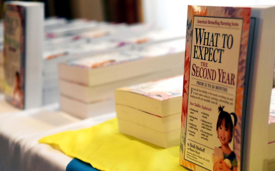 The What to Expect series of books, ready to be signed by author Heidi Murkoff at the Special Delivery baby shower event, at Grafenwoehr, Germany, Wednesday, March 14, 2018.