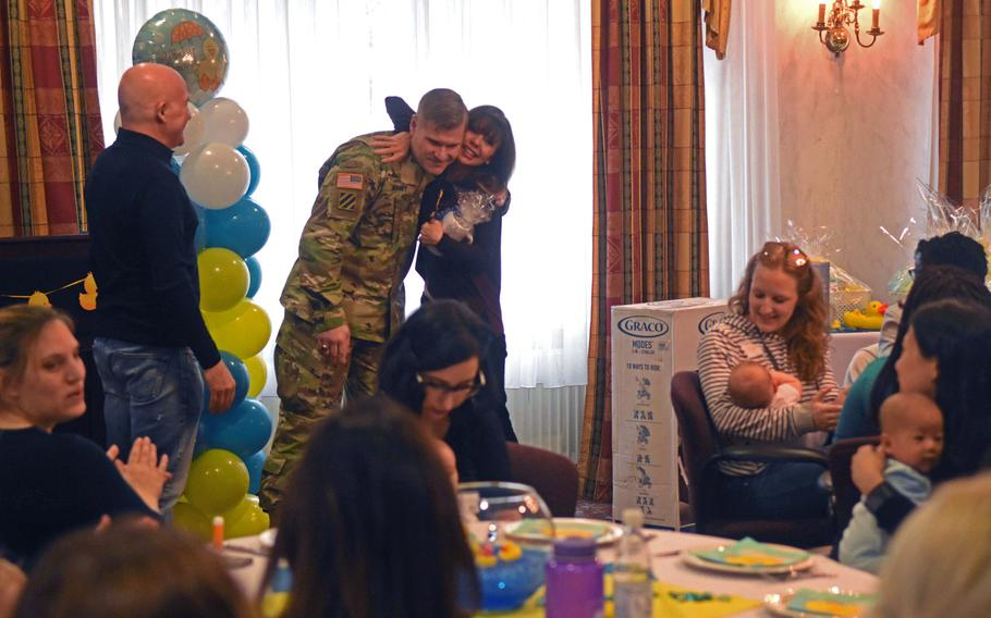 Col. Lance. Varney gets a suprise hug from Heidi Murkoff, author of the What to Expect series, at the Special Delivery baby shower event, at Grafenwoehr, Germany, Wednesday, March 14, 2018.