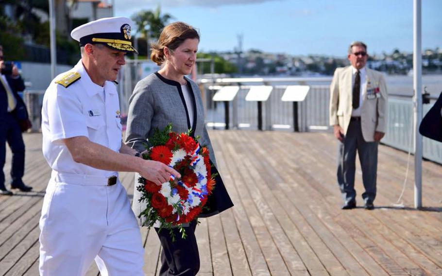 Vice Adm. Phil Sawyer, 7th Fleet commander, and U.S. Consul General Valerie Fowler prepare to lay a wreath at the Submariners Walk Heritage Trail in Brisbane, Australia, Thursday, March 15, 2018.