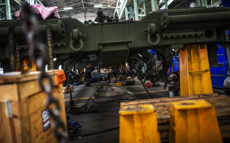 Workers at the Heavy Equipment Division reconstruct a truck bed at Camp Carroll, South Korea, Tuesday, March 6, 2018.