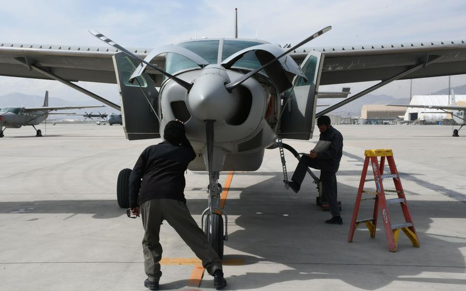 Afghan maintainers perform a post-operating inspection on a Cessna 208 Caravan at Hamid Karzai International Airport in Kabul on Tuesday, March 6, 2018.
