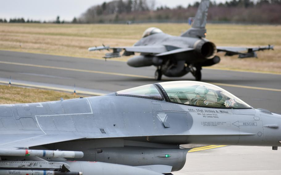 F-16 fighter jets from the 112th Expeditionary Fighter Squadron, deployed to Europe as part of a theater security package from Toledo Air National Guard Base, Ohio, prepare for takeoff on Tuesday, March 13, 2018, at Spangdahlem Air Base, Germany. The jets were participating in a large-scale basewide exercise with Spangdahlem personnel.