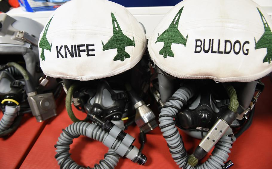 Helmets worn by F-16 pilots with the 480th Fighter Squadron at Spangdahlem Air Base, Germany, display pilots' call signs on Tuesday,  March 13, 2018.