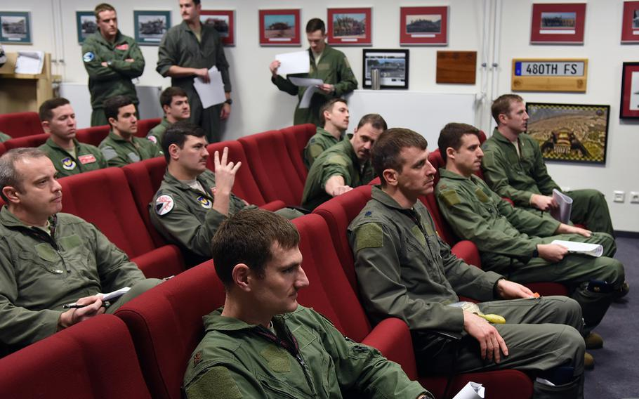 Ohio National Guard F-16 pilots with the 112th Expeditionary Fighter Squadron from Toledo join pilots with the 480th Fighter Squadron at Spangdahlem Air Base, Germany, for a joint pre-flight briefing on Tuesday, March 13, 2018. The squadrons flew numerous sorties while training together during a basewide exercise that coincided with the Ohio pilots' deployment to Europe.
