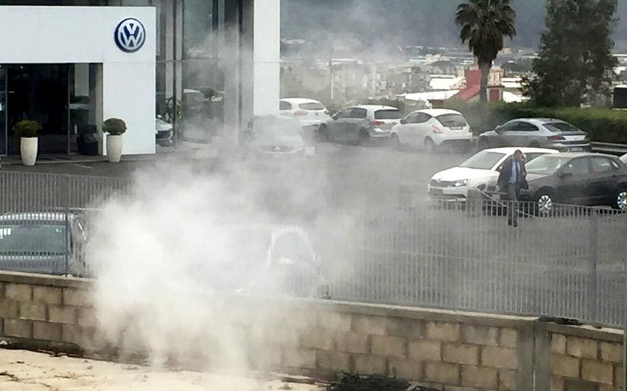 One of Campi Flegrei's sulphurous craters emits steam at a Volkswagen dealership in Pozzuoli, Italy, on March 6, 2018. Researchers say the underground supervolcano, which covers 90 square miles, has become more active and unpredictable and could erupt in the future.
