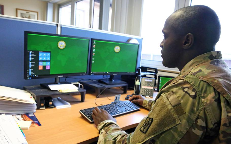 U.S. Army Staff Sgt. Johnnie Robinson, 2nd Theater Signal Brigade command group noncommissioned officer, uses a government computer with the Windows 10 operating system, Oct. 2, 2017, in Wiesbaden, Germany.