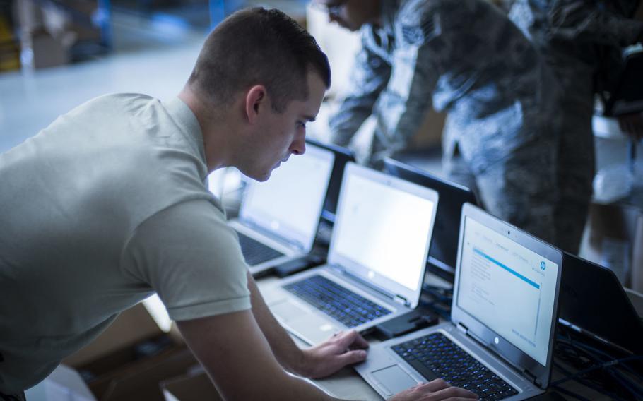 Senior Airman Zach Wilt, 49th Communications Squadron cyber operator, installs Microsoft Windows 10 to a laptop at Holloman Air Force Base, N.M., Nov. 1, 2017.