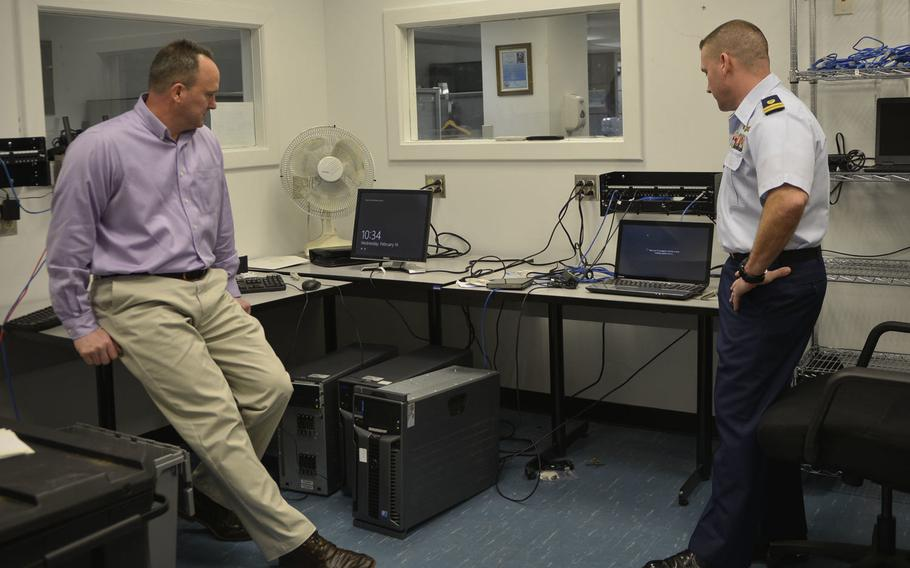 Lt. Edward Costa, right, and Michael Galicki discuss the challenges of the Windows 10 upgrade Wednesday, Feb. 14, 2018.