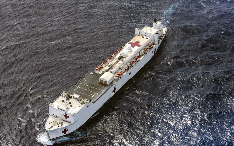 Military Sealift Command hospital ship USNS Mercy transits the waters near Guam en route for Pacific Partnership 2018 Friday, March 16, 2018. The Navy proposes mothballing one of its two hospital ships to free money to spend on warships, submarines and aircraft.